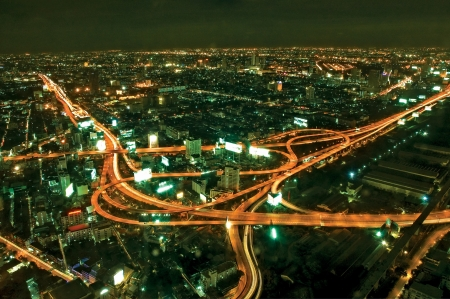 Night view above city shows transportation in metropolis. photo
