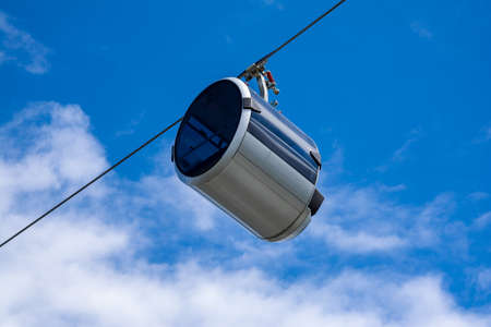 Modern cable car with a cabin in the form of a capsule.
