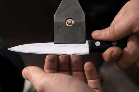 Check the sharpened knife for burrs 写真素材