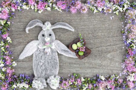 The composition of the rabbit from the leaves of the flower Stakhis and the frame of flowers Spirea and Veronica.