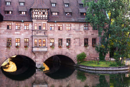 Hospital of the Holy Spirit in the city of Nuremberg in Germany on the river Pegnitz