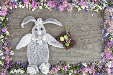 The composition of the rabbit from the leaves of the flower Stakhis and the frame of flowers Spirea and Veronica Reklamní fotografie