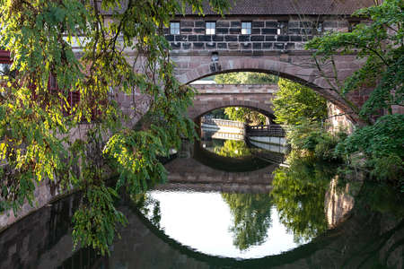 View of the bridge in the form of a building on the Pegnitz River in Nuremberg Germany Imagens