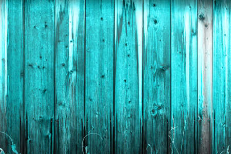Wooden wall with a protective layer of blue paint 写真素材