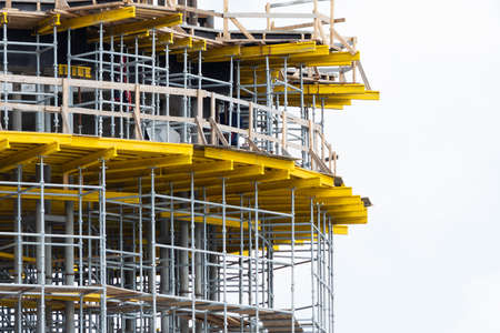 View of scaffolding and structural reinforcement during the construction of a round building