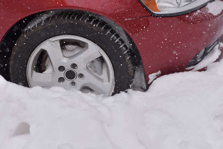 winter tires: Car with winter tires on the snow covered road