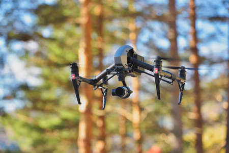 Flying drone on natural background