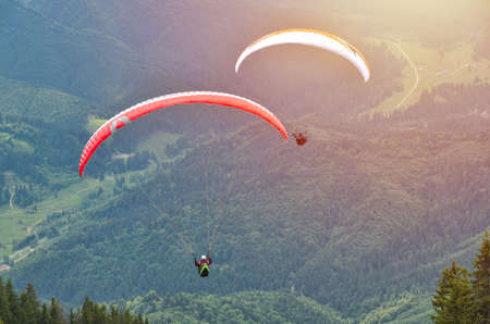 Paraglider taking off in front of spectacular mountain scenery