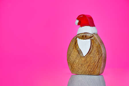 Lovely Merry Christmas and Happy new Year 2019, with Santa wood figurine isolated on white background with copy space