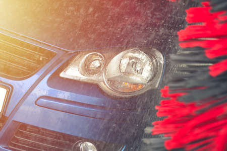 Automatic car wash in action. Car wash concept. Automated technology Stock Photo