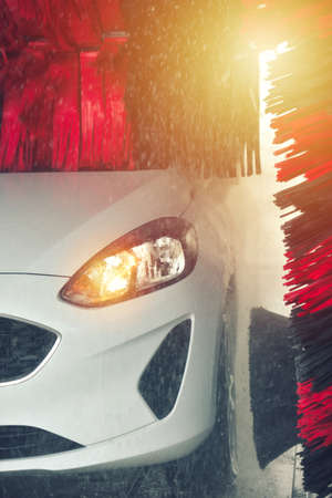 Automatic car wash in action. Car wash concept. Automated technology Banco de Imagens
