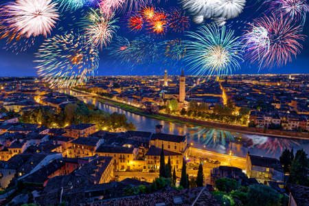 Colorful Fireworks above Verona Cityscape, in Italy, Celebrating New Years Eve