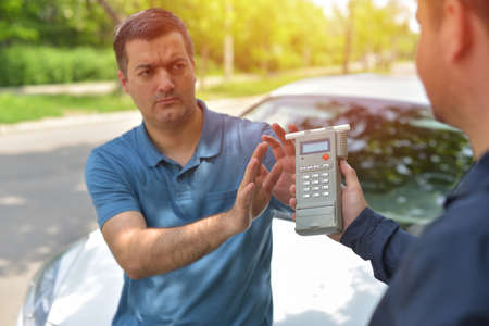 Driver due to being subject to test for alcohol content with use of breathalyzer Stock Photo