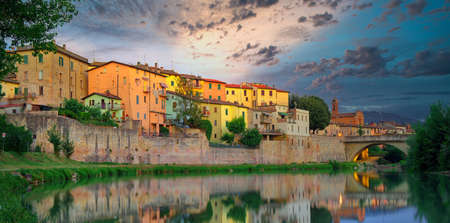 Old italian city Umbertide near Tevere river with cloudy sunset light Banco de Imagens
