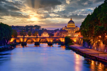 Wonderful view of St Peter Cathedral, Rome, Italy. Sunset light with cloudy sky