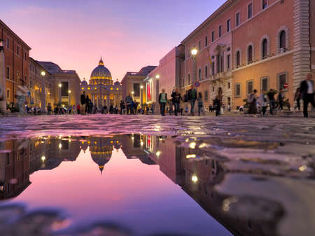 Wonderful view of St Peter Cathedral, Vatican, Rome, Italy. Sunset sky with night city lights
