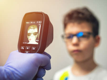 A thermal scanner for Fever And Symptoms of Coronavirus at College, School, Office, Mall or Hospital