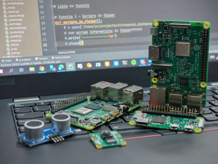 Galati, ROMANIA - November 02, 2020: Close-up of Raspberry Pi 4 Model-B, Raspberry Pi 3 Model-B and Raspberry Pi Zero W on a laptop keyboard. The Raspberry Pi is a credit-card-sized single-board computer developed in the UK Editorial