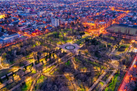 Galati, Romania - February 28, 2021: Aerial view of Galati City, Romania, at sunset with city lights on