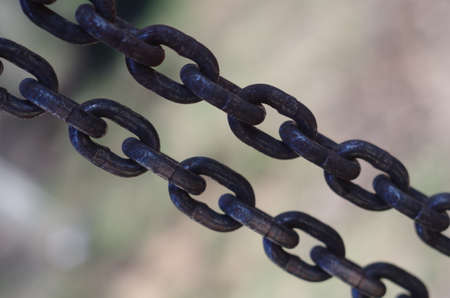Two tense rusrty chains closeup Stock Photo