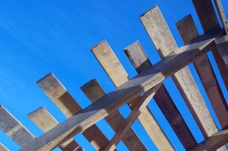 truss: wooden truss against the blue sky