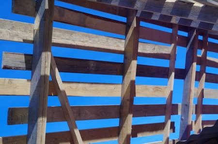struts: wooden truss against the blue sky