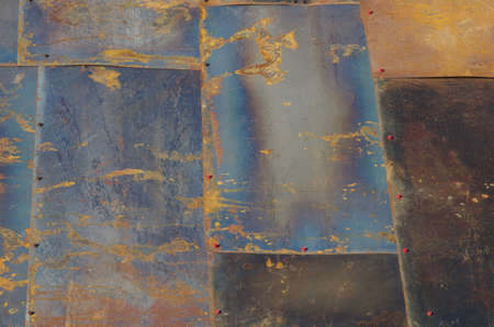 not painted: Not painted iron sheets close up with screws hats and rust. Stock Photo