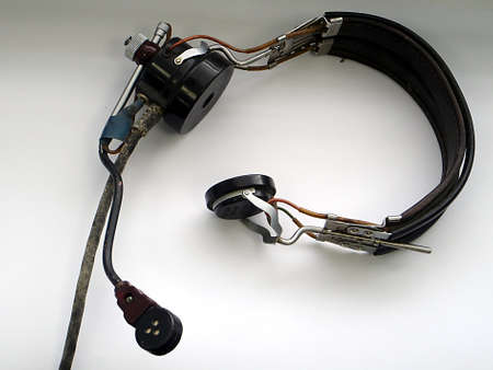 Aged used headset on a white background