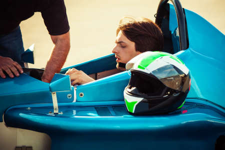 bolid: driver in race car prepare for race