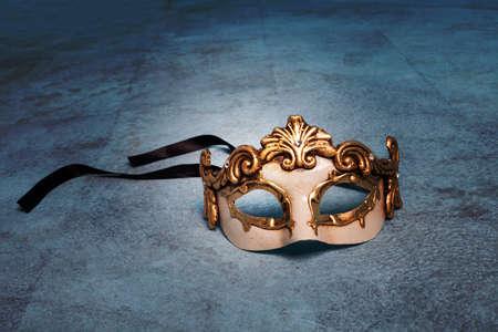 festal: Venetian mask on blue grunge floor Stock Photo