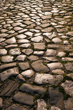 vertical orientation: cobbled road as background and texture, vertical orientation