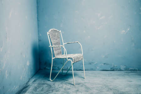 grunge room: white chair in blue grunge room Stock Photo