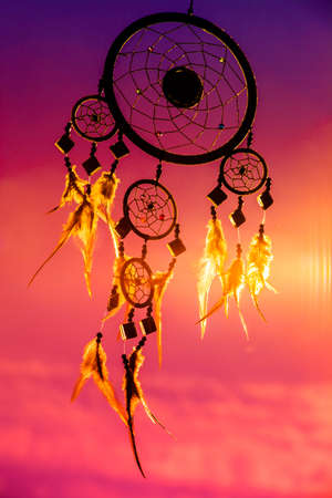 power nap: dream catcher with sky at sunset in background Stock Photo