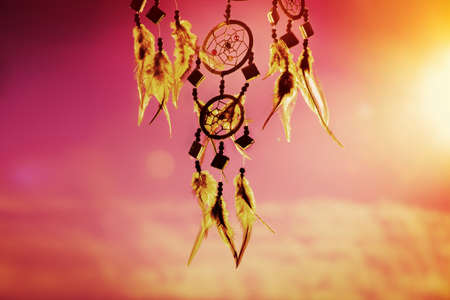 conection: dream catcher with sky at sunset in background Stock Photo