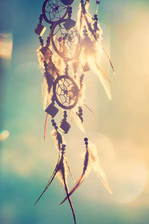 dreams: dream catcher with sky at sunset in background Stock Photo