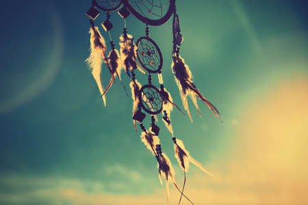 native american indian: dream catcher with sky at sunset in background Stock Photo