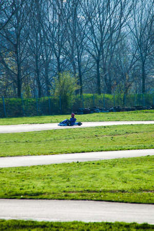 carting: driver in karting car on track outdoor Stock Photo