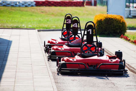 small butt: go kart cars in row outdoor track
