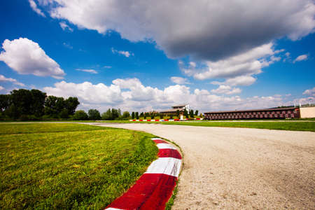 race track: empty motor speedway with curve in the forefront