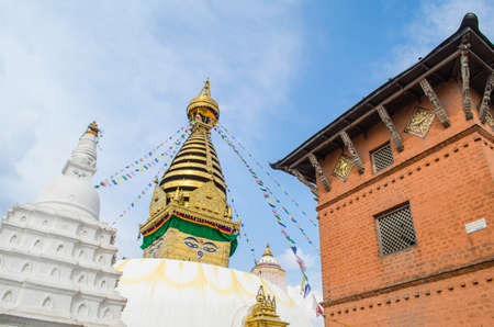 the famous buuha eye gazing out sleepily from each side of the tower are those of the all seeing primordial buddha.perched a top a hill on the western edge of the kathmandu valley. Editorial