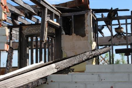 state owned: Burned, tornado damaged home