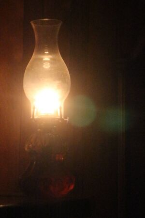 oil lamp: Lit Oil Lamp