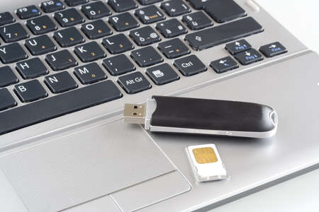 Notebook with modem usb Stock Photo - 4015295