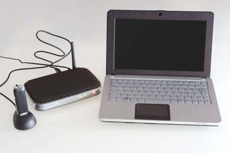 isdn: Netbook with router modem 3G Stock Photo