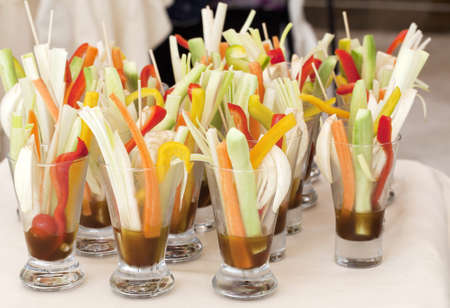 Cutted vegetables in glasses