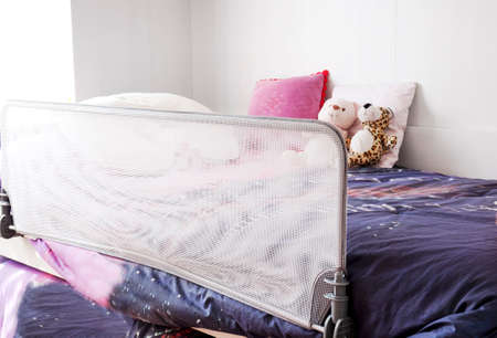 child protection: Child bed with safety protection Stock Photo