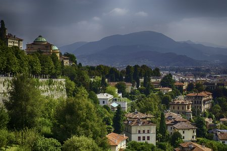 quiet and old European town with mountainous backdrop
