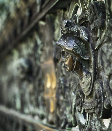 ironwork of a lady on a grille