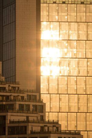golden reflection on glass facade