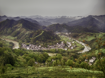 Chinese village settlement beside a river bend